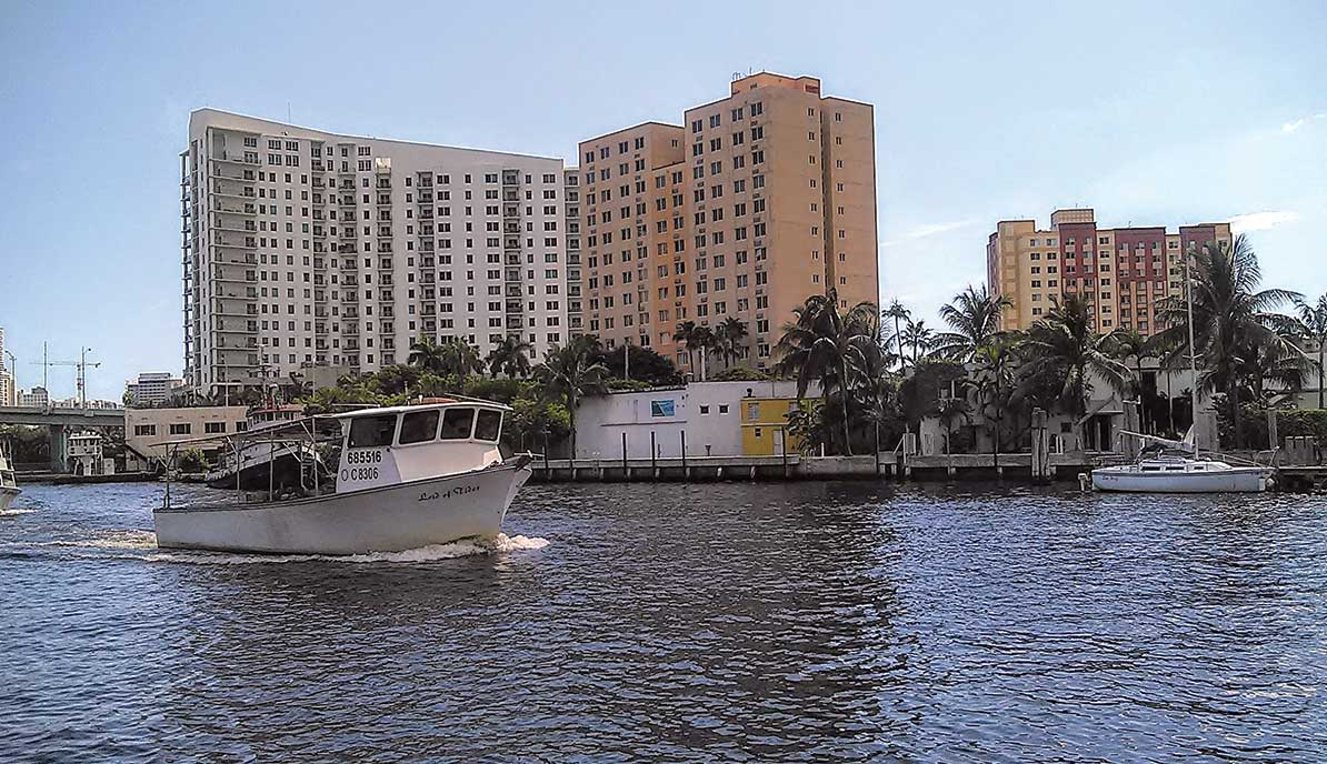 Restaurant complex plan meets Miami River's grit