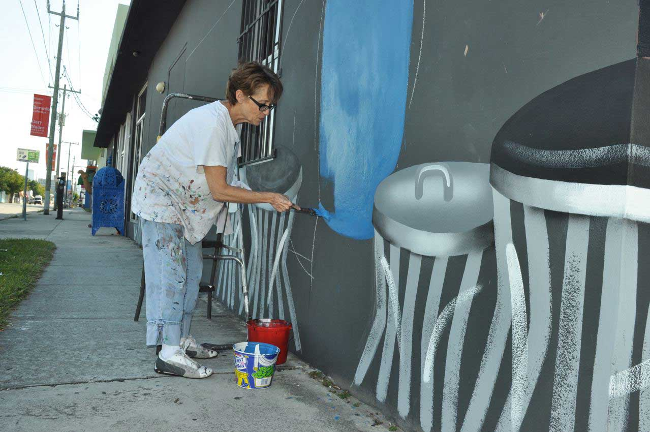 Robin Morris paints on the façade of 2632 N Miami Ave. in 2012.