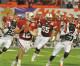 Funds handoff to Orange Bowl team?