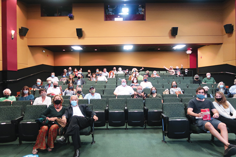 Limited-capacity movie theaters fill, add programming